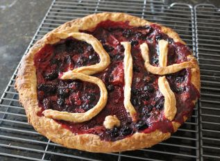By Evan Shelhamer (Pi Day Pie) [CC BY 2.0 (http://creativecommons.org/licenses/by/2.0)], via Wikimedia Commons